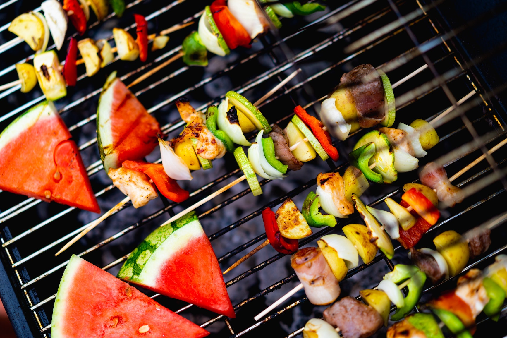 Food grilling on a barbecue provided in our rooftop lounges.